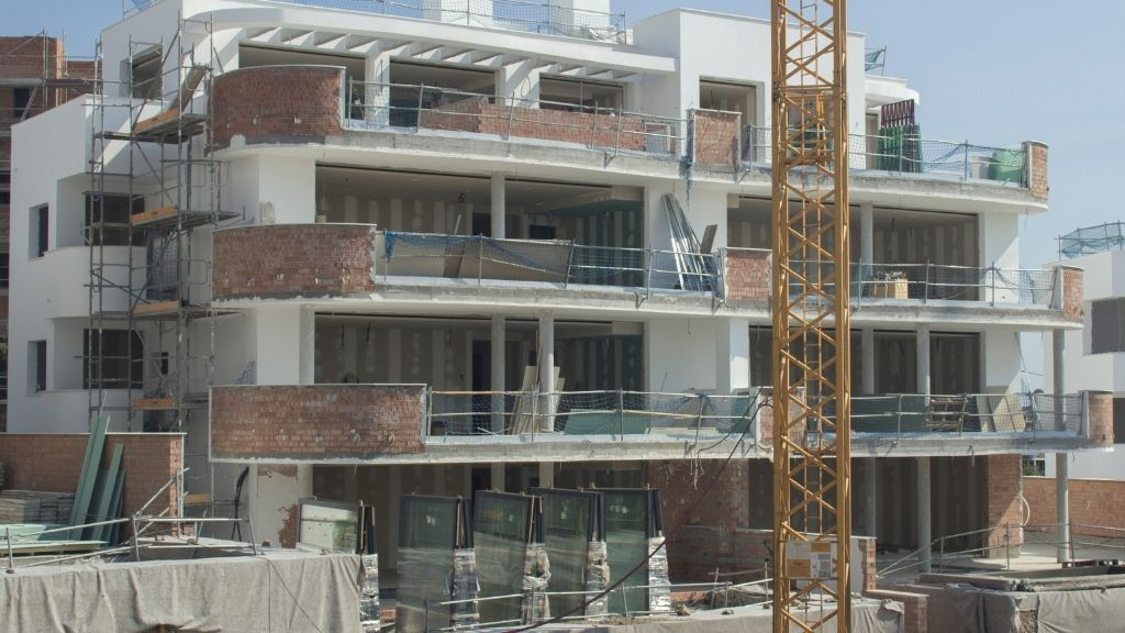 Phase III - 2020 10 Block 42 facade is rendered with glass terrace doors ready to go in