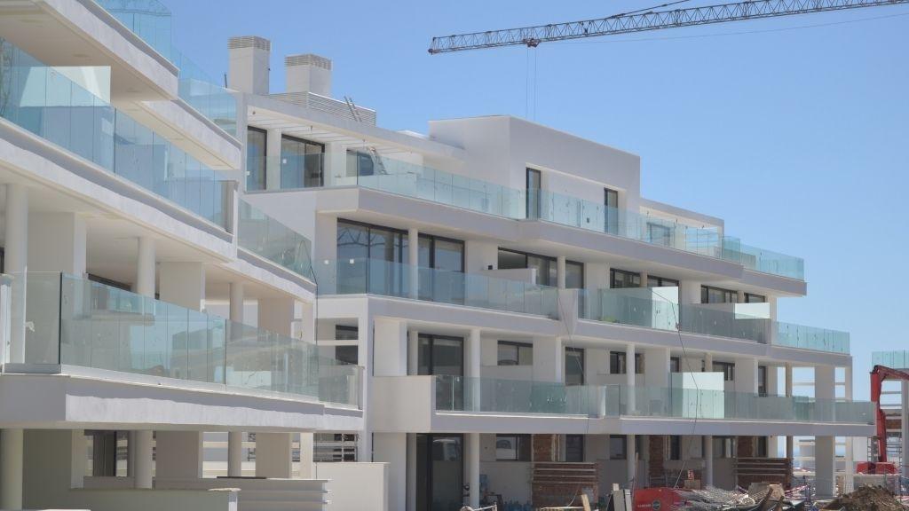 Phase II - 2021 03 Dividing walls go up between Garden Villas in Blocks 15 and 16