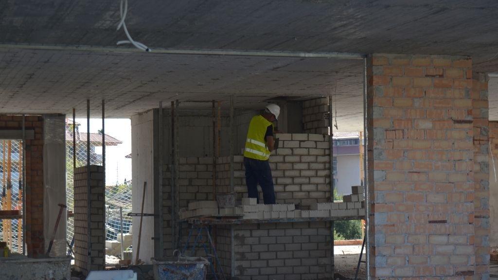 Phase VI - 2021 04 Brick walls are built inside Phase VI
