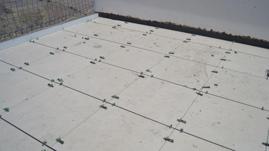 Phase V - 2021 04 Floor tiles in progress on the terraces in Phase V