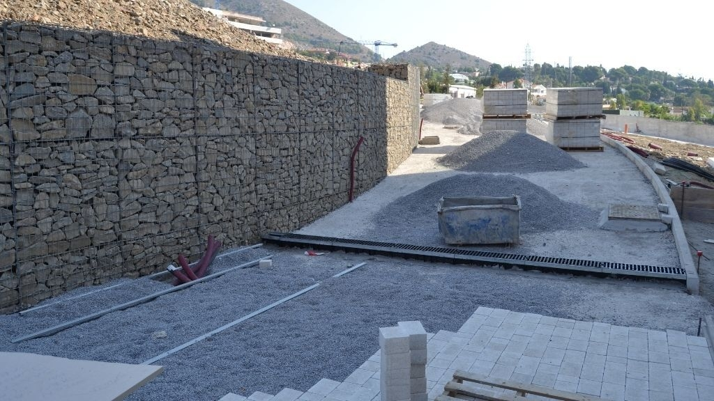 Phase V - 2021 09 The paved areas take shape as cobblestones are laid